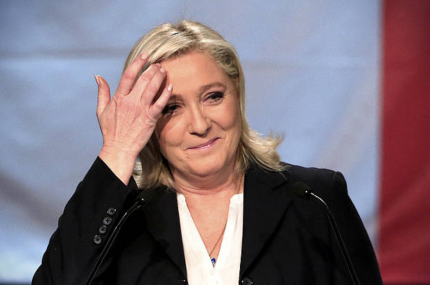 French National Front political party leader and candidate Marine Le Pen reacts as she delivers her speech after the announcement of the results during the first round of the regional elections in Henin-Beaumont, France, December 6, 2015. REUTERS/Pascal Rossignol - RTX1XGBC