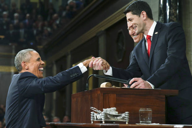 U.S. President Barack Obama (L) is welcomed by House Speaker Paul Ryan (R-WI) (R) and Vice President Joe Biden prior to delivering his final State of the Union address to a joint session of Congress in Washington January 12, 2016. REUTERS/Evan Vucci/Pool - RTX224SD
