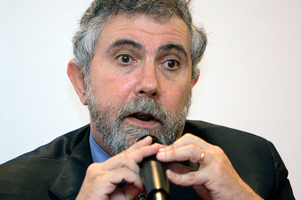 Nobel Prize-winning economist Paul Krugman speaks during a press conference at the World Capital Markets Symposium in Kuala Lumpur, Malaysia, Monday, Aug. 10, 2009. Aggressive stimulus spending by governments helped the world avoid a second Great Depression but full economic recovery will take two years or more, Krugman said Monday. (AP Photo/Lai Seng Sin)