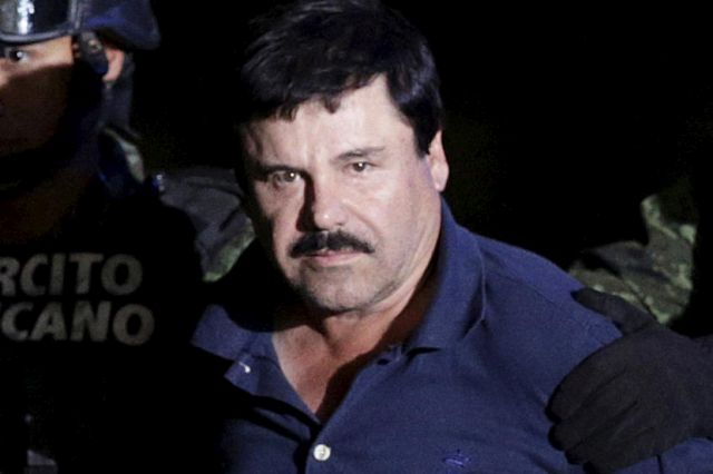 "Recaptured drug lord Joaquin ""El Chapo"" Guzman is escorted by soldiers at the hangar belonging to the office of the Attorney General in Mexico City, Mexico January 8, 2016. Picture taken January 8, 2016. REUTERS/Henry Romero - RTX21OFZ"