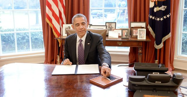 President Barack Obama signs presidential memorandum on paid leave to federal employees in the Oval Office of the White House, January 15, 2015. (Photo By Olivier Douliery/ISP) *** Please Use Credit from Credit Field *** (Newscom TagID: sipaphotosfive158173.jpg) [Photo via Newscom]