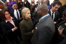 Democratic presidential candidate Hillary Clinton speaks with an audience member at the House Of Prayer Missionary Baptist Church, Sunday, Feb. 7, 2016 in Flint, Mich. (AP Photo/Paul Sancya)
