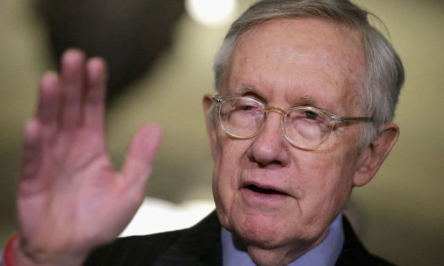 WASHINGTON, DC - JANUARY 12: Senate Minority Leader Harry Reid (D-NV) (C) talks to reporters following the Senate Democratic caucus policy luncheon at the U.S. Capitol January 12, 2016 in Washington, DC. Reid enumerated what he believes are President Barack Obama's greatest political accomplishments ahead of tonight's State of the Union speech. (Photo by Chip Somodevilla/Getty Images)