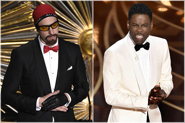 Sacha Baron Cohen, left, and Olivia Wilde speak at the Oscars on Sunday, Feb. 28, 2016, at the Dolby Theatre in Los Angeles. (Photo by Chris Pizzello/Invision/AP)