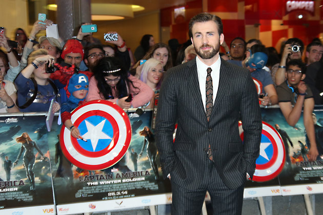 U.S. actor Chris Evans poses for photographers as he arrives for the UK premiere of the movie Captain America: The Winter Soldier at the Vue Westfield on Thursday, March 20, 2014 in London. (Photo by Joel Ryan/Invision/AP Images)