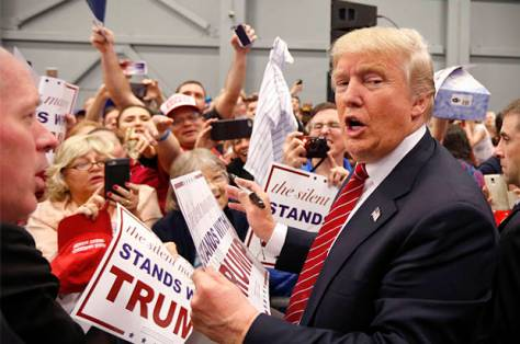 Republican presidential candidate Donald Trump greets supporters after speaking at a campaign rally in New Orleans, Friday, March 4, 2016. (AP Photo/Gerald Herbert)