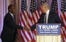 Former Republican presidential candidate Ben Carson shakes hands with Republican presidential candidate Donald Trump, after announcing he will endorse Trump during a news conference at the Mar-A-Lago Club, Friday, March 11, 2016, in Palm Beach, Fla.