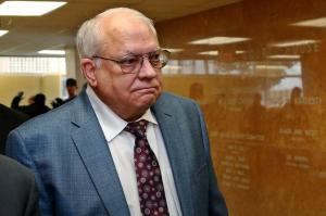 FILE - In this Tuesday, April 21, 2015 file photo, Robert Bates arrives for his arraignment at the Tulsa County courthouse in Tulsa, Okla. More than four weeks after the 73-year-old Tulsa County volunteer deputy shot an unarmed man in the back, and following allegations of mismanagement at the sheriff's office, the Oklahoma State Bureau of Investigation said it isn't inspecting the case because public officials haven't asked it to, Friday, May 1, 2015. (AP Photo/Sue Ogrocki, File)