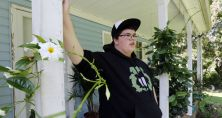 Gavin Grimm leans on a post on his front porch during an interview at his home in Gloucester, Va. Schools can't prevent transgender students from using the restrooms that correspond with their gender identities without violating federal law, the Obama administration says. | AP