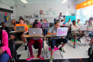 Students at Lovett Elementary, the Clinton, Miss. school district's sixth-grade-only school, work on laptops during class. The district has provided iPads or laptops to all students for several years.