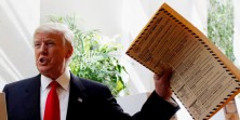 Republican presidential candidate Donald Trump lifts his ballot while voting for the New York primary election in the Manhattan borough of New York City, U.S., April 19, 2016. REUTERS/Andrew Kelly