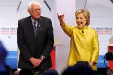 Democratic presidential candidates Sen. Bernie Sanders, I-Vt, left, and Hillary Rodham Clinton take the stage before a Democratic presidential primary debate at the University of Wisconsin-Milwaukee, Thursday, Feb. 11, 2016, in Milwaukee. (AP Photo/Morry Gash)