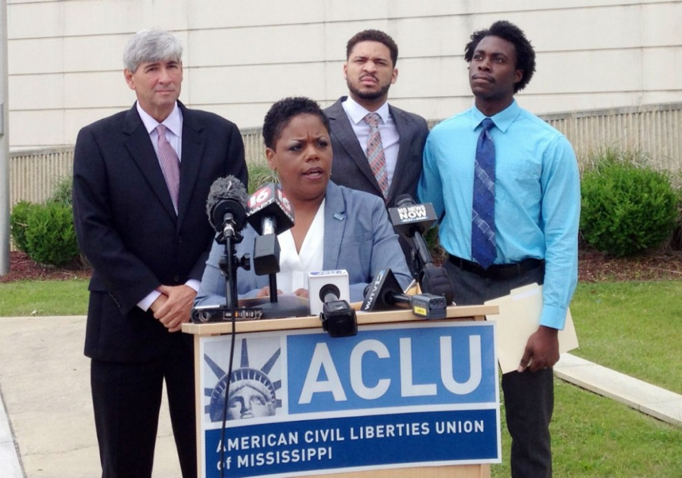 Jennifer Riley-Collins, executive director of the American Civil Liberties Union of Mississippi, introduces the lawsuit, flanked by attorney Oliver Diaz, and plaintiffs Nykolas Alford and Stephen Thomas.
