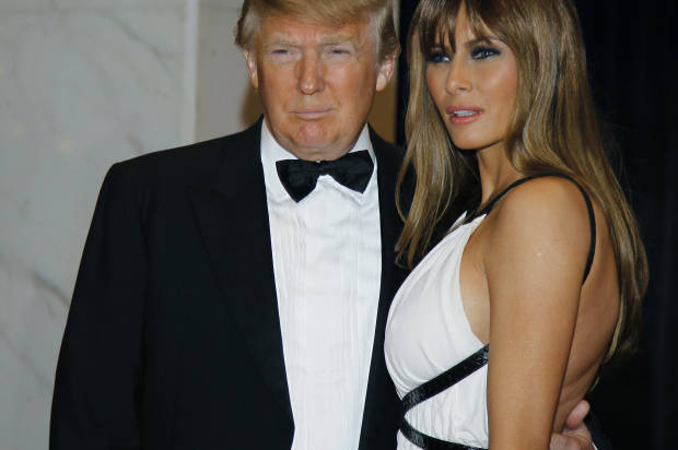 FILE - In this April 30, 2011, file photo Donald Trump, left, and Melania Trump arrive for the White House Correspondents Dinner in Washington. He won't be on November's ballot, but President Barack Obama is slowly embracing his role as the anti-Trump, taking on the Republican front-runner in ways that no other Democrat can. Obama's public scolding of Trump, who for years peddled inaccurate claims about Obama's birth certificate, dates back to 2011, when Obama roasted him at the dinner. Trump was visibly humiliated as Obama lobbed joke after joke at him on national television. (AP Photo/Alex Brandon, File)