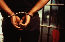 Handcuffed Prisoner/GETTY