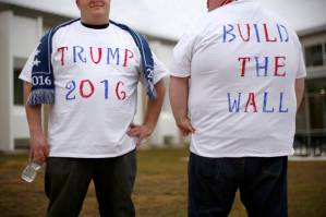 Cory McSweeney, 23, of Middlesborough, Mass., left, and Thomas Harrahan, 20, of Weymouth, Mass., supporters of Republican presidential candidate Donald Trump, pose in their homemade t-shirts while waiting for the doors to open for a Trump rally, Thursday, Feb. 4, 2016, in Portsmouth, N.H. (AP Photo/Robert F. Bukaty)