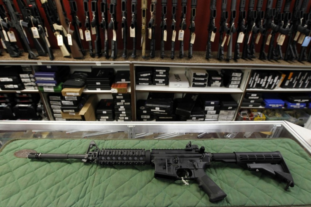 In this Thursday, July 26, 2012 file photo, an AR-15 style rifle is displayed at the Firing-Line indoor range and gun shop, in Aurora, Colo.