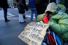 FILE - In this Jan. 5, 2016, file photo, a homeless woman, who only wanted to be identified as Lala, asks for money on a street corner in New York. Dealing with New York City's homeless has become a contentious issue between New York Gov. Andrew Cuomo and the city's mayor, Bill de Blasio. Cuomo promised his own proposal and will likely reference it in his State of the State address on Wednesday, Jan. 13, 2016. (AP Photo/Seth Wenig, File)
