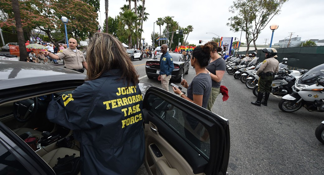 Members of the FBI Joint Terrorism task force stand by to provide security for the 2016 Gay Pride Parade on Sunday in Los Angeles. | Getty
