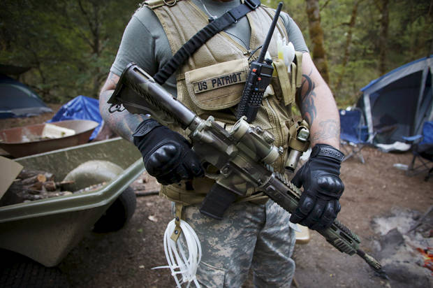 Members of the Oath Keepers provide security at the Sugar Pine Mine outside Grants Pass, Oregon April 22, 2015. The owners of the Oregon gold mine who called in armed activists the Oath Keepers to protect their claim amid a bitter land use dispute with the U.S. government have appealed a federal stop-work order, U.S. officials said on Thursday. Photo taken April 22, 2015. REUTERS/Jim Urquhart - RTX1A1JO