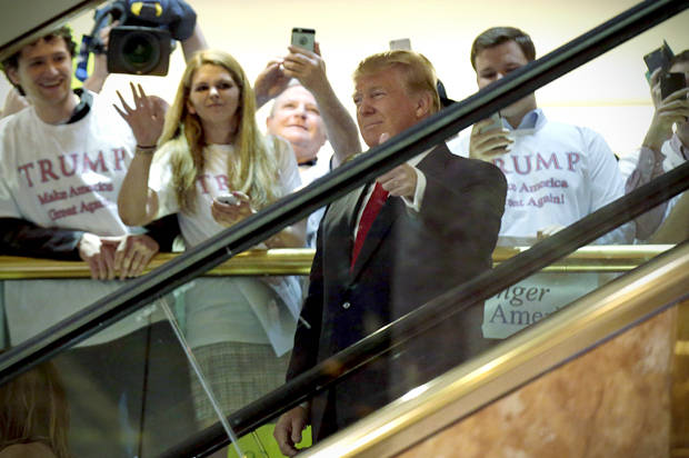 U.S. Republican presidential candidate, real estate mogul and TV personality Donald Trump arrives by escalator inside at Trump Tower to announce his campaign for the 2016 Republican presidential nomination in New York June 16, 2015. REUTERS/Brendan McDermid - RTX1GRJP