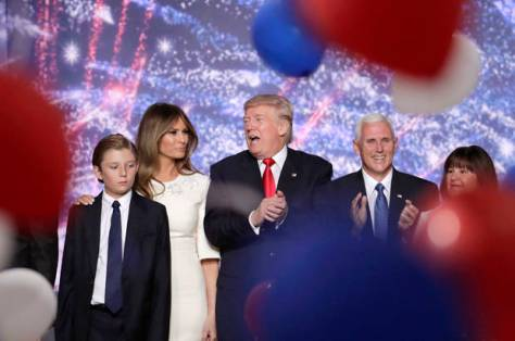 Republican Presidential Candidate Donald Trump, talks with wife Melania as he stands with son Barron and Republican Vice Presidential Nominee Gov. Mike Pence of Indiana and his wife Karen as the ballots fall at the conclusion of the Republican National Convention in Cleveland, Thursday, July 21, 2016. (AP Photo/J. Scott Applewhite)