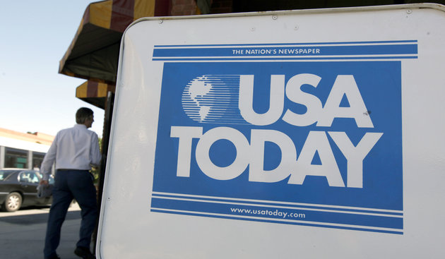 FILE - In this file photo taken Sept. 29, 2009, a USA Today newspaper box is shown outside a restaurant in Charlotte, N.C. Gannett Co., the largest U.S. newspaper publisher, said Friday, April 16, 2010, its first-quarter profit jumped 51 percent as the economic slump eased. Its shares surged in premarket trading. (AP Photo/Chuck Burton, File)