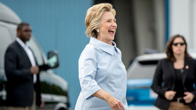 Democratic presidential candidate Hillary Clinton arrives to board a new campaign plane at the Westchester County Airport in White Plains, N.Y., Monday, Sept. 5, 2016, to travel to Cleveland Hopkins International Airport for Labor Day events. (AP Photo/Andrew Harnik)
