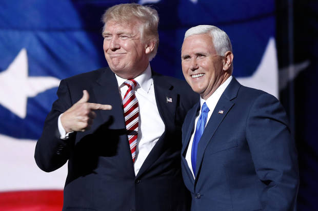 "FILE – In this July 20, 2016 file photo, Republican presidential candidate Donald Trump, points toward Republican vice presidential candidate Indiana Gov. Mike Pence after Pence's acceptance speech during the third day session of the Republican National Convention in Cleveland. Two new photo exhibits running until Election Day show how images and video sway opinions and capture votes. This photo will be included in the International Center of Photography's show in Long Island, New York, exploring how photos affect voters, from snapshots of John F. Kennedy to Barack Obama's ""Hope"" poster. (AP Photo/Mary Altaffer, File)"