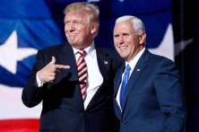 """FILE – In this July 20, 2016 file photo, Republican presidential candidate Donald Trump, points toward Republican vice presidential candidate Indiana Gov. Mike Pence after Pence's acceptance speech during the third day session of the Republican National Convention in Cleveland. Two new photo exhibits running until Election Day show how images and video sway opinions and capture votes. This photo will be included in the International Center of Photography's show in Long Island, New York, exploring how photos affect voters, from snapshots of John F. Kennedy to Barack Obama's """"Hope"""" poster. (AP Photo/Mary Altaffer, File)"""
