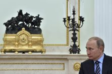 Russian President Vladimir Putin listens to Prince Albert II of Monaco at the Kremlin in Moscow, Russia, on Thursday, Oct. 6, 2016. (Yuri Kadobnov/AP)