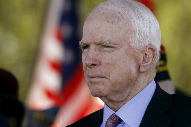FILE - In this Monday, May 30, 2016, Sen. John McCain, R-Ariz, looks on during a Phoenix Memorial Day Ceremony at the National Memorial Cemetery of Arizona in Phoenix. Eight years after stumping across the nation as the Republican Party's presidential candidate, McCain is back on the campaign trail in his home state as he faces a primary challenge and a strong Democratic opponent in the general election. (AP Photo/Ralph Freso, File)