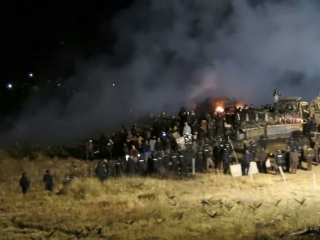 Violent confrontations between Native American protesters and militarized police continue.