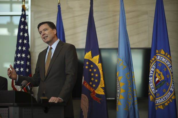 FBI Director James Comey speaks during a news conference Tuesday afternoon June 7, 2016, in Minneapolis, Minn., while in town as part of a two-day regional visit. (Jeff Wheeler/Star Tribune via AP) MANDATORY CREDIT; ST. PAUL PIONEER PRESS OUT; MAGS OUT; TWIN CITIES LOCAL TELEVISION OUT