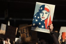 A protester holds a sign at San Francisco International Airport during a demonstration to denounce President Donald Trump's executive order that bars citizens of seven predominantly Muslim-majority countries from entering the U.S. Saturday, Jan. 28, 2017, in San Francisco.