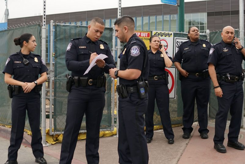 Customs and Border Protection agents Friday at the San Ysidro Port of Entry in California. (Sandy Huffaker/AFP/Getty Images)