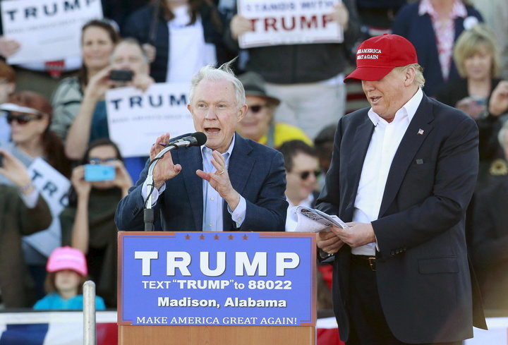 U.S. Senator Jeff Sessions speaks next to U.S. Republican presidential candidate Donald Trump at a rally at Madison City Schools Stadium in Madison, Alabama February 28, 2016. REUTERS/Marvin Gentry